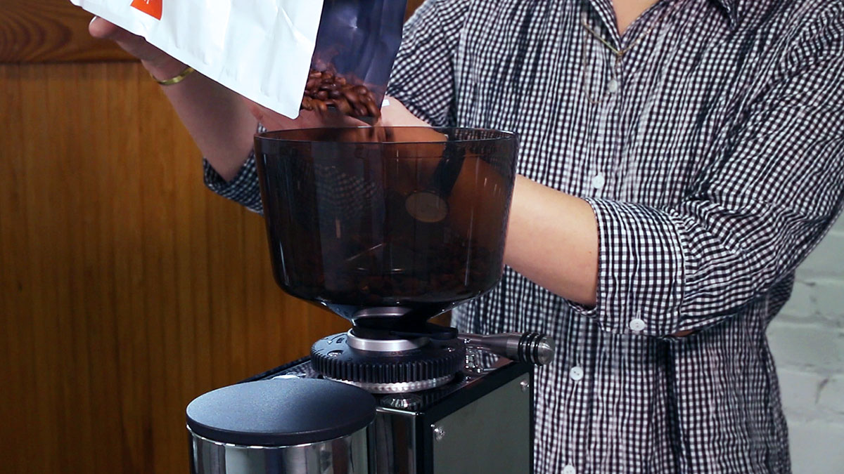 Pouring-coffee-into-hopper.jpg